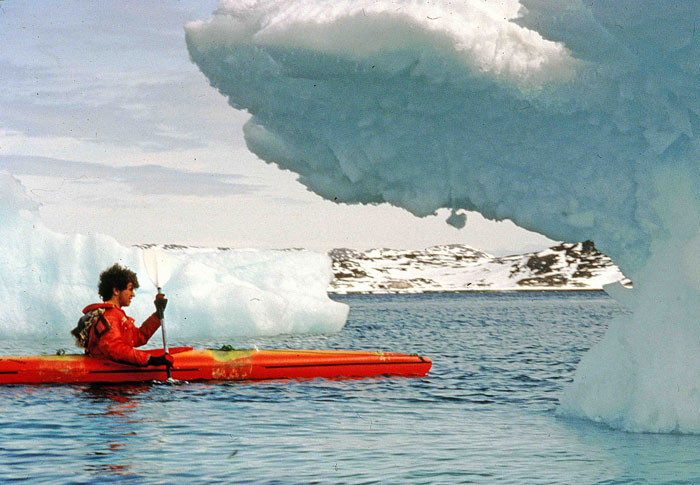 Kayak in Greenland. Ramon Larramendi assiat kayak among icebergs