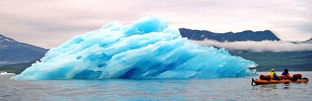 kayak in greenland, blue iceberg narsaq