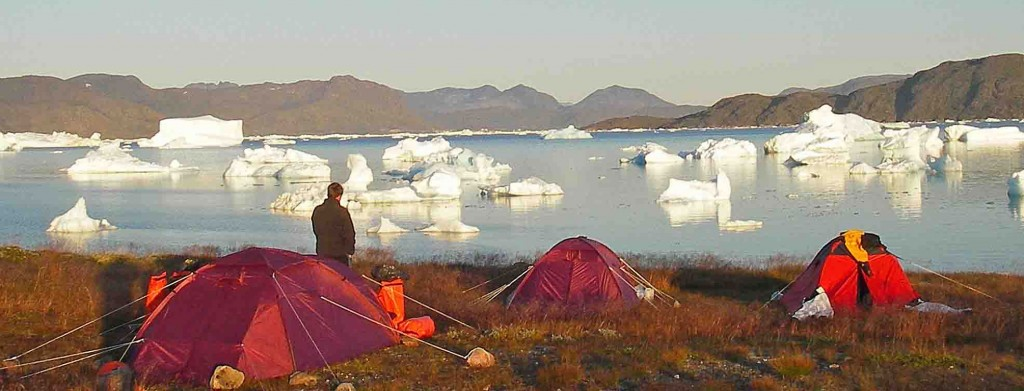 kayak in Greenland. Tasiusaq camp beside icebergs