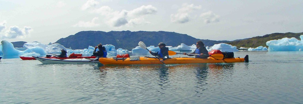 kayak in Greenland. Bike, trekking and Tasiusaq kayaking among icebergs